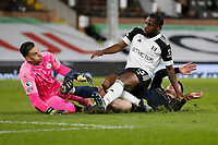 Sport Bilder des Tages 13th March 2021, Craven Cottage, London, England;  Fulhams Josh Onomah shoots but sees his effort saved by keeper Ederson during the English Premier League match between Fulham and Manchester City at Craven Cottage in London