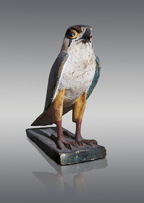Ancient Egyptian wooden falcon bird, Late Period (722-322 BC). Egyptian Museum, Turin. Grey background. <br /> <br /> Wooden tomb models were an Egyptian funerary custom from the Middle Kingdom in which wooden figurines and sets were constructed to be placed in the tombs of Egyptian royalty. These wooden models represented the work of servants, farmers, other skilled craftsman, armies, and religious rituals