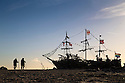 28/11/16<br /> <br /> As the cold front sweeps in with blue skies and freezing temperatures, a walkers admire the Black Pearl pirate ship, made completely out of driftwood, on New Brighton beach with the Liverpool skyline and Royal Liver Bird building in the background. The boat was built in 2013 by local artist Frank Lund and his friend Major Mace using materials found on their beach walks. The work of art has survived numerous storms and being set alight by vandals and is now a popular spot for tourists and locals alike. There was even a pirate wedding held on its deck last year.<br /> <br /> All Rights Reserved F Stop Press Ltd. (0)1773 550665   www.fstoppress.com