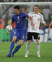 Bastian Schweinsteiger, Vincenzo Iaquinta.  Italy defeated Germany, 2-0, in overtime in their FIFA World Cup semifinal match at FIFA World Cup Stadium in Dortmund, Germany, July 4, 2006.