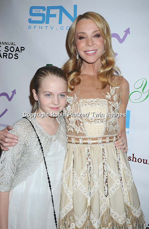 Signy Coleman in Valentino gold dress and daughter Isabella Nolan posing for photographers at the 3rd Annual Indie Soap Awards on February 21, 2012 at New World Stages .in New York City.