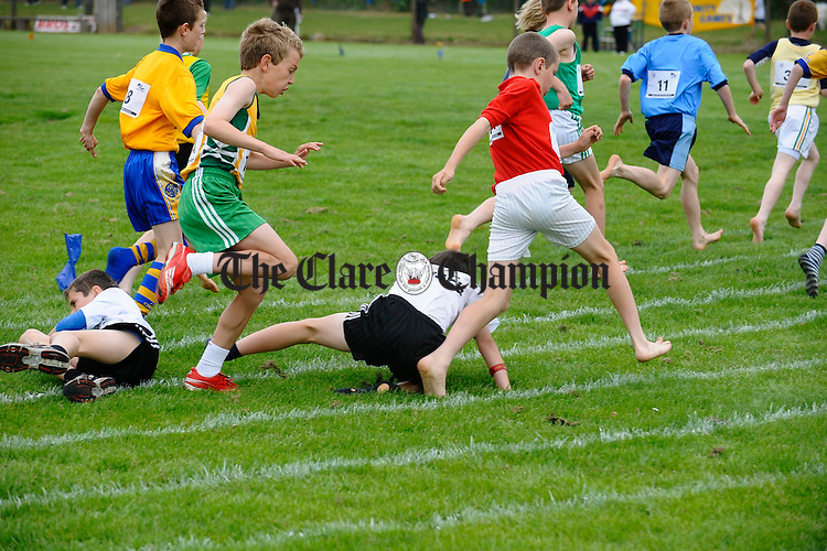 A mix up at the first bend for these competitiors at the Clare Community Games Athletics finals in Rosslevan. Photograph by John Kelly.