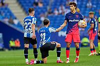 12th September 2021: Barcelona, Spain:  Joao Felix of Atletico de Madrid helps up Raul de Tomas of RCD Espanyol during the Liga match between RCD Espanyol and Atletico de Madrid at RCDE Stadium in Cornella, Spain.