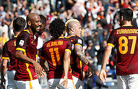 Calcio, Serie A: Roma vs Napoli. Roma, stadio Olimpico, 25 aprile 2016.<br /> Roma's Radja Nainggolan, second from right, celebrates with teammates after scoring the winning goal during the Italian Serie A football match between Roma and Napoli at Rome's Olympic stadium, 25 April 2016. Roma won 1-0.<br /> UPDATE IMAGES PRESS/Riccardo De Luca