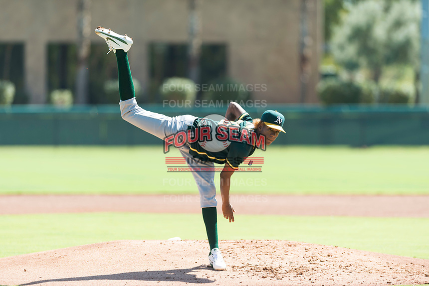 Oakland Athletics relief pitcher Wilkin Ramos (50) follows through on his delivery during an Instructional League game against the Los Angeles Dodgers at Camelback Ranch on September 27, 2018 in Glendale, Arizona. (Zachary Lucy/Four Seam Images)