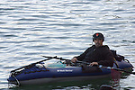 MAN IN INFLATABLE DINGHY in BAY OUTSIDE CANDLESTICK BASEBALL STADIUM