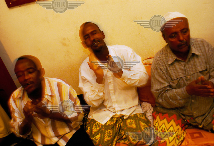 Sufis perform Zikr (recitation of the name of Allah) in a house in the city. Sufism, which is active in Somaliland, is the mystical branch of mainstream Islam. Sufis may not necessarily embrace only Islam, but will respect all faiths as they seek the path of truth that lies at their core.