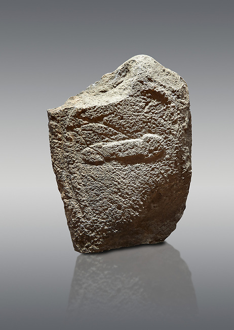 Late European Neolithic prehistoric Menhir standing stone with carvings on its face side. The representation of a stylalised male figure with the remains of a  carving of a dagger running horizontally across the menhir. Excavated from Cuccu de Lai,  Samugheo. Menhir Museum, Museo della Statuaria Prehistorica in Sardegna, Museum of Prehoistoric Sardinian Statues, Palazzo Aymerich, Laconi, Sardinia, Italy. Grey background.