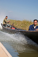 Myanmar, Burma.  Motorized Canoes Provide Main form of Transportation, Inle Lake, Shan State.