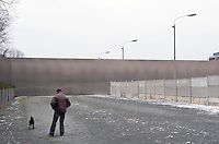 Man with his dog at the Berlin Wall Memorial at Bernauer Strasse in Berlin.