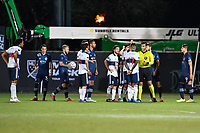 LAKE BUENA VISTA, FL - JULY 26: Referee Victor Rivas speaks to Leonard Owusu of Vancouver Whitecaps FC during a game between Vancouver Whitecaps and Sporting Kansas City at ESPN Wide World of Sports on July 26, 2020 in Lake Buena Vista, Florida.