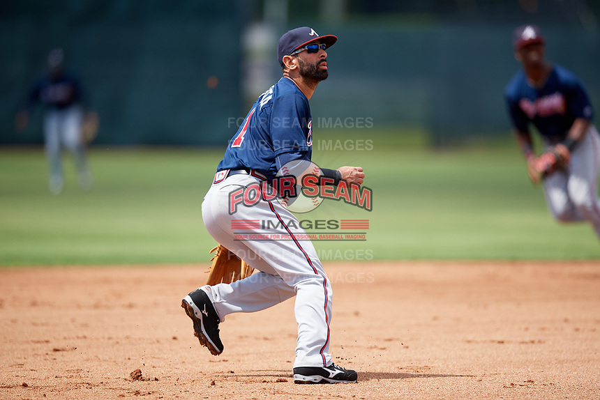 Atlanta Braves third baseman Jose Bautista (1) breaks on a high chopper during a Minor League Extended Spring Training game against the Philadelphia Phillies on April 20, 2018 at Carpenter Complex in Clearwater, Florida.  (Mike Janes/Four Seam Images)
