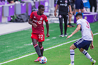 ORLANDO, FL - APRIL 24: Richie Laryea #22 of Toronto FC kicks the ball during a game between Vancouver Whitecaps and Toronto FC at Exploria Stadium on April 24, 2021 in Orlando, Florida.