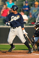 Charleston right fielder Jose Tabata (#39) follows through on an RBI single in the first inning versus Kannapolis at Fieldcrest Cannon Stadium in Kannapolis, NC, Friday, April 28, 2006.  The River Dogs defeated the Intimidators 8-0.