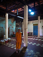 Portrait of a Buddhist Monks  in the Monastery kitchen. Old Monastery in Battambang, Cambodia