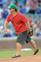 Actor Jim Belushi throws out the first pitch between the Miami Marlins and the Chicago Cubs at Wrigley Field on July 17, 2012 in Chicago, Illinois. The Marlins defeated the Cubs 9-5. (Tony Farlow/Four Seam Images).