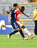 BOGOTA - COLOMBIA - 01 - 03 - 2018: Juan Valencia (Der.) jugador de Independiente Santa Fe disputa el balón con Robert Burbano (Izq.) jugador de Emelec (ECU), durante partido entre Independiente Santa Fe (COL) y Emelec (ECU), de la fase de grupos, grupo 4, fecha 1 de la Copa Conmebol Libertadores 2018, jugado en el estadio Nemesio Camacho El Campin de la ciudad de Bogota. / Juan Valencia (R) player of Independiente Santa Fe vies for the ball with Robert Burbano Independiente Santa Fe (COL) and Emelec (ECU), of the group stage, group 4, 1st date for the Conmebol Copa Libertadores 2018 at the Nemesio Camacho El Campin Stadium in Bogota city. Photo: VizzorImage  / Luis Ramirez / Staff.