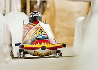 8 January 2016: Nick Cunningham, piloting his 2-man bobsled for the United States of America, enters the Chicane straightaway on his second run, ending the day with a combined 2-run time of 1:51.43 and earning a 6th place finish at the BMW IBSF World Cup Championships at the Olympic Sports Track in Lake Placid, New York, USA. Mandatory Credit: Ed Wolfstein Photo *** RAW (NEF) Image File Available ***