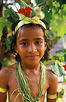 Young native girl wearing traditional ceremonial costume prepares for dance in Ma Village, Yap, Micronesia.