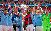 Vincent Kompany & Sergio Agüero of Man City lift the trophy as the celebrate with teammates during the FA Cup FINAL match between Manchester City and Watford at Wembley Stadium, London, England on 18 May 2019. Photo by Andy Rowland.<br /> .<br /> Editorial use only, license required for commercial use. No use in betting,<br /> games or a single club/league/player publications.'