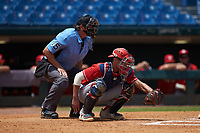 Catcher Ian Moller (40) of Wahlert Catholic School in Dubuque, IA playing for the Cincinnati Reds scout team frames a pitch as home plate umpire Lance Weems looks on during the East Coast Pro Showcase at the Hoover Met Complex on August 5, 2020 in Hoover, AL. (Brian Westerholt/Four Seam Images)