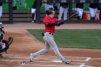 Cedar Rapids Kernels first baseman Edouard Julien (25) swings at a pitch during a game against the Wisconsin Timber Rattlers on September 8, 2021 at Neuroscience Group Field at Fox Cities Stadium in Grand Chute, Wisconsin.  (Brad Krause/Four Seam Images)