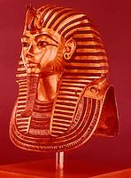 Egypt:  Gold Mask--gold with gems.  Treasures of Tutankhamun, Cairo Museum.  MMA 1976.