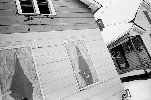 Cleveland, Ohio.March 11, 2008 ..Boarded up homes that have been foreclosed on in intercity Cleveland. Nearly every street in the city has at least one of these homes. Most have several. The owners of the homes, in many cases the mortgage companies, have the responsibility of maintaining the homes. Often squatters, drug dealers and the homeless move into the abandon homes. Many times the copper pipes and wiring are stripped out of the homes by thieves to sell as scarp metal.These homes, which have figures drawn on the doors and windows to give the impression that someone is home, are in an area know as ..Slavic Village. Once a nice working class neighborhood of Polish and people of other Slavic origins, it is now heavily hit by the mortgage crisis and many of the homes are boarded up and foreclosed..