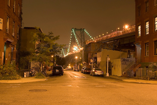 Street Scene at Night in the Williamsburg Neighborhood of Brooklyn, Williamsburg Bridge in the background, New York City, New York City, USA