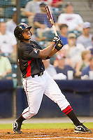 Sharlon Schoop #14 of the Richmond Flying Squirrels follows through on his swing against the Harrisburg Senators in game two of a double-header at The Diamond on July 22, 2011 in Richmond, Virginia.  The Senators defeated the Flying Squirrels 1-0.   (Brian Westerholt / Four Seam Images)
