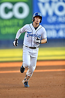 Asheville Tourists Kyle Datres (3) rounds the bases after hitting a home run during a game against the Charleston RiverDogs at McCormick Field on August 16, 2019 in Asheville, North Carolina. The Tourists defeated the RiverDogs 12-3. (Tony Farlow/Four Seam Images)