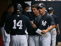 April 3, 2010:  Manager Joe Girardi of the New York Yankees talks with Curtis Granderson (14) in the annual Futures Game during Spring Training at Legends Field in Tampa, Florida.  Photo By Mike Janes/Four Seam Images