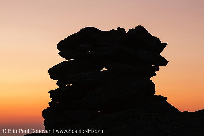 The silhouette of a rock cairn on the summit of Mount Washington at dusk in the White Mountains, New Hampshire.