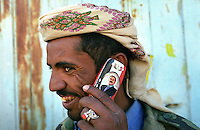 Portrait of the Yemeni President Ali Abdullah Saleh on a mobile phone in the Yemeni capital of Sana'a.