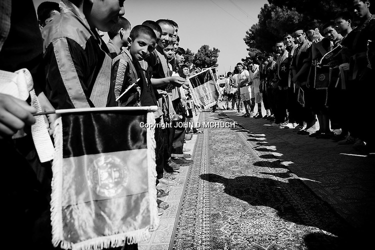 Football fans wait for the Afghan National Soccer team's arrival at an official reception in Mazar-e Sharif, 24 September 2013. Mazar-e Sharif was the first stop on a nationwide tour after Afghanistan's victory at the South Assian federation Football Cup. (John D McHugh)