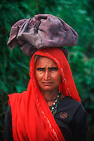 Indian women carrying bag on head, Rajasthan, India