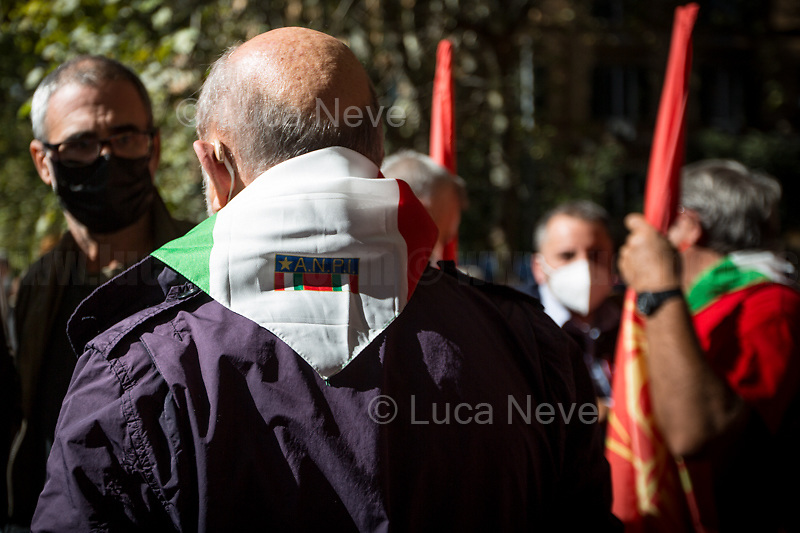 """Associazione Nazionale Partigiani d'Italia ANPI - National Association of Italian Partizans, Members of the Italian Resistance in WWII.<br /> <br /> Rome, Italy. 10th October, 2021. Today, thousands of people gathered outside the CGIL (CGIL Confederazione Generale Italiana del Lavoro, Italian General Confederation of Labour, Italian biggest Trade Union) HQ in Corso d'Italia in Rome to attend the Trade Union emergency General Assembly called after the vile attack perpetrated yesterday against the CGIL HQ by the fascist organization forza nuova (for a previous demo: 2.), members of no vax, no pass, no green pass, football supporters, conspiracy theorists, far-right extremists, Covid-19 deniers (negazionisti). The General Secretary of the CGIL, Maurizio Landini, in his today speech stated that what happened yesterday was a """"fascist and squad action"""" against the Workers, the founding values of the Italian Democratic Republic, the principles enshrined in the Constitution born of anti-fascism, the Resistance and the Liberation Struggle. He added that the fascist organizations (Illegal in Italy) need to be immediately dismatled, that this kind of despicable actions against Democracy cannot be tolerated, calling for a national Antifascists demonstration on the 16th October 2021 in Rome.<br /> <br /> Footnotes & Links:<br /> 1. http://cgil.it/ & https://bit.ly/2E1Al5a (Wikipedia)<br /> 2. 24.07.21 - No Green Pass Demo - Far-right, NoGreenPass, NoVax, Covid19 Deniers, Conspiracy Theorists https://lucaneve.photoshelter.com/gallery/24-07-21-No-Green-Pass-Demo-Far-right-NoGreenPass-NoVax-Covid19-Deniers-Conspiracy-Theorists/G0000m5VttrwCq6A/C0000GPpTqAGd2Gg"""