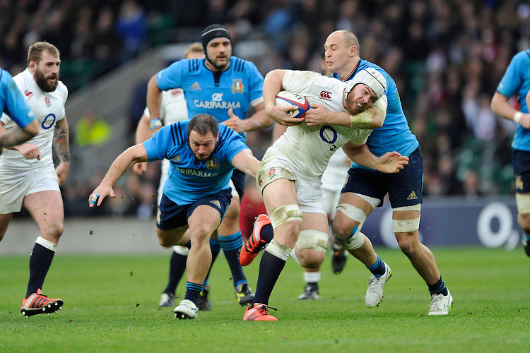 Dave Attwood of England drives forward as he is tackled by Leonardo Ghiraldini and Sergio Parisse of Italy during the RBS 6 Nations match between England and Italy at Twickenham Stadium on Saturday 14th February 2015 (Photo by Rob Munro)