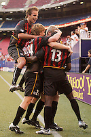 The MetroStars' John Wolyniec gets mobbed by teammates Mike Magee, Eddie Gaven, and Cornell Glen after he scored the MetroStar's third goal in the 64th minute. The NY/NJ MetroStars defeated the LA Galaxy 3 to 0 during MLS action at Giant's Stadium, East Rutherford, NJ, on June 5, 2004.