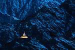 Built on a mountain ledge with spectacular views, the Shanti Stupa in Leh, India, is situated at a breathtaking 13,999 ft elevation. Enshrined in its base are relics of the Buddha. It is a Peace Pagoda, built by the Japanese and Ladakh Buddhists to promote world peace and commemorate 2500 years of Buddhism.