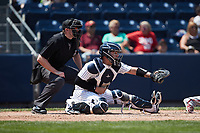 Scranton/Wilkes-Barre RailRiders catcher Donny Sands (33) sets a target as home plate umpire Jacob Metz looks on during the game against the Rochester Red Wings at PNC Field on July 25, 2021 in Moosic, Pennsylvania. (Brian Westerholt/Four Seam Images)