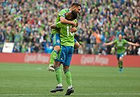 SEATTLE, WA - NOVEMBER 10: Seattle Sounders defender Kelvin Leerdam #18 celebrates with forward Raul Ruidiaz #9 after scoring a goal during a game between Toronto FC and Seattle Sounders FC at CenturyLink Field on November 10, 2019 in Seattle, Washington.