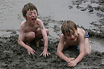 Playing in the mud of a pond in Stonewall, TX<br /> The boys are Owen and Rowan