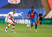 12th September 2020; Selhurst Park, London, England; English Premier League Football, Crystal Palace versus Southampton; Wilfried Zaha of Crystal Palace being marked by Jack Stephens of Southampton