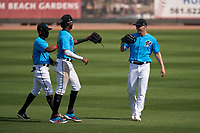 Miami Marlins outfielders Magneuris Sierra (34), Lewis Brinson (25), and JJ Bleday (67) celebrate closing out a Major League Spring Training game against the Houston Astros on March 21, 2021 at Roger Dean Stadium in Jupiter, Florida.  (Mike Janes/Four Seam Images)