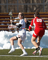 Boston College midfielder Sarah Mannelly (6) passes the ball. .Boston College (white) defeated Boston University (red), 12-9, on the Newton Campus Lacrosse Field at Boston College, on March 20, 2013.