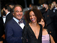 CANNES, FRANCE. July 10, 2021: Oliver Stone & Sun-jung Jung at the Flag Day Premiere at the 74th Festival de Cannes.<br /> Picture: Paul Smith / Featureflash