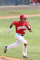 J.C. Cardenas (18) of the Vancouver Canadians runs to first base during a game against the Eugene Emeralds at Nat Bailey Stadium on July 22, 2015 in Vancouver, British Columbia. Vancouver defeated Eugene, 4-2. (Larry Goren/Four Seam Images)