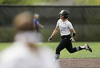 Bentonville second baseman Emily Perry (20) runs home for a score off of a home run, Thursday, April 29, 2021 during a softball game at Bentonville High School in Bentonville. Check out nwaonline.com/210430Daily/ for today's photo gallery. <br /> (NWA Democrat-Gazette/Charlie Kaijo)