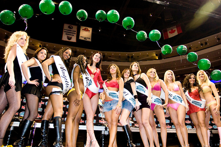 """The Wingettes face off for the title of Ms. Wing Bowl at the 14th annual Wing Bowl, held in Philadelphia on February 3, 2006 at the Wachovia Center.<br /> <br /> The Wing Bowl is a competitive eating event in which eaters try and down the most hot wings in 30 total minutes in front of a crowd of 10,000 plus people.  The real show however is all around the eaters, from the various scantily clad women (known as """"Wingettes"""") that make up eaters' entourages, to the behavior of the fans themselves."""